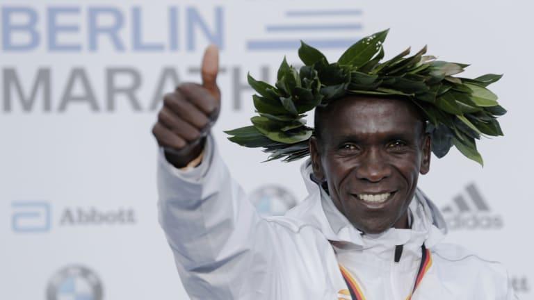 Landmark: Eliud Kipchoge celebrates during the medal ceremony for the Berlin Marathon.