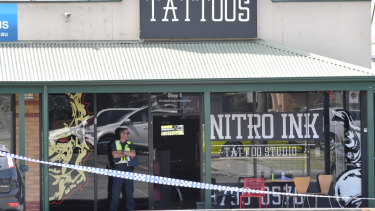 Police on the scene at the Nitro Ink tattoo parlour after Ale's shooting last year.