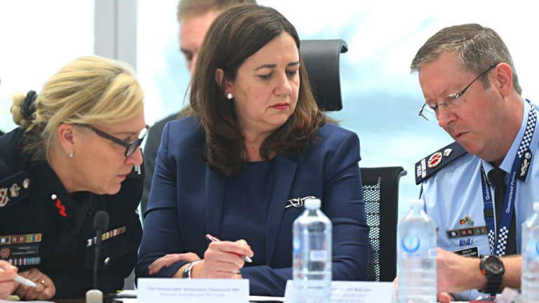 Queensland Fire and Emergency Services Commissioner Katarina Carroll, Premier Annastacia Palaszczuk and State Disaster Coordinator Bob Gee review the latest reports on the bushfires.