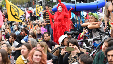Protesters leave their Carlton Gardens base camp to march to Flinders Street. on Monday