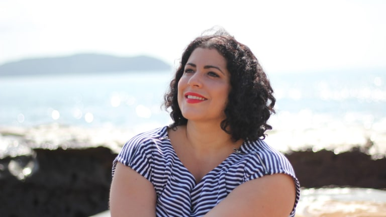Born and bred Canberra woman Cristina San Martin has given up her permanent APS6 role to become a psychic and healer.
