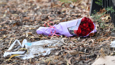 Flowers at the site of an car accident with killed a young girl in Rowville.