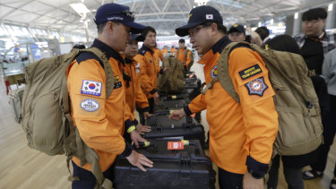 South Korean rescue team members prepare to board a plane to leave for Budapest at Incheon International Airport in Incheon, South Korea.