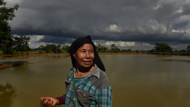 Noy Kerdkaew walks around her flooded rice farm near Tham Luang cave, Thailand.