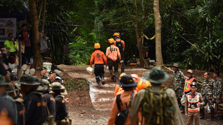 Thai soldiers and rescuers go through an exercise at the base camp.
