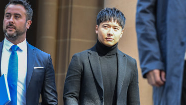 Chinese actor Yunxiang Gao (right) is seen leaving Central Court in August.
