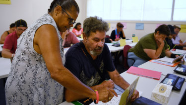 Literacy for Life facilitator Judy McGuinness talking to student Charles Booth, 63, at his first literacy class in Airds.