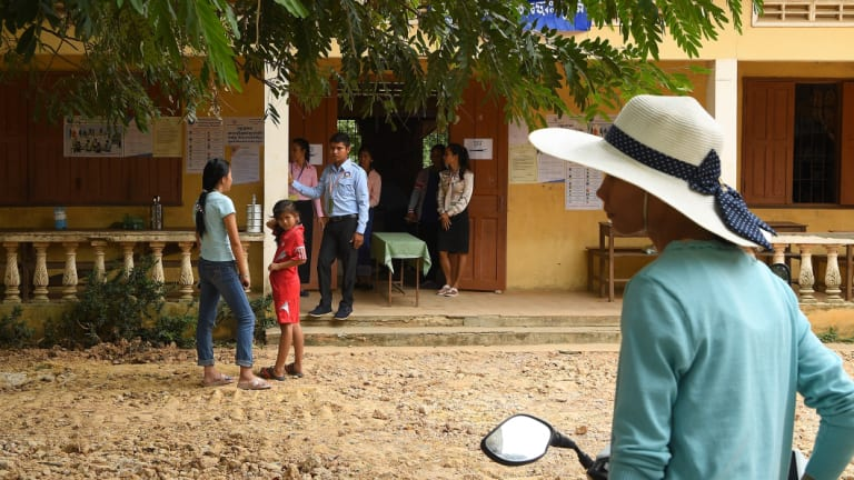 People arrive to cast their vote at Koktrob School in Kbal Seh village, in Kandal Province.