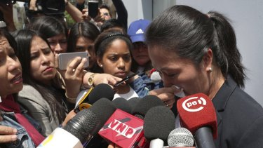 Keiko Fujimori, daughter of Peru's former president Alberto Fujimori, cries as she speaks with reporters outside of her father's home in Lima, Peru on Wednesday.
