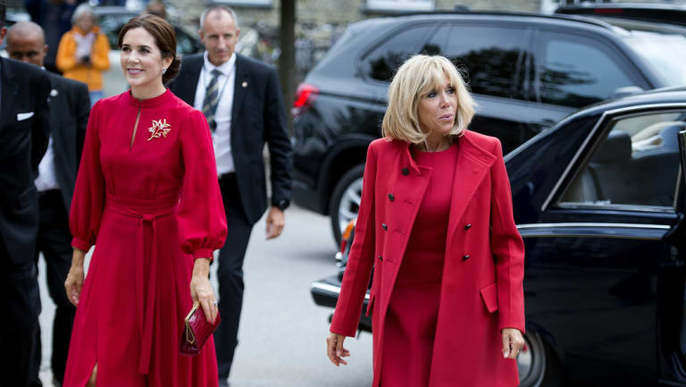Twinning ... Denmark's Crown Princess Mary (left) and French first lady Brigitte Macron both chose red when they met in Copenhagen this week.