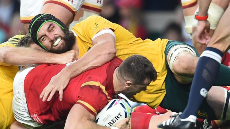 Advantage Australia: Gareth Davies is stopped short of the Wallabies' try line by Scott Fardy during their Rugby World Cup 2015 pool A match. Australia won the clash 15-6.