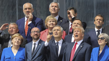 From the left, German Chancellor Angela Merkel, Belgian PM Charles Michel, NATO Secretary-General Jens Stoltenberg, US President Donald Trump and British PM Theresa May pose with other leaders for a family picture at NATO in Brussels.