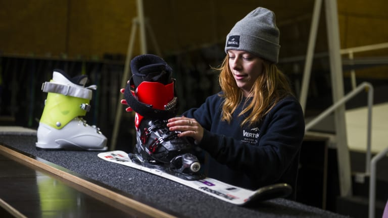 From the Rocky Mountains to south Canberra: ski instructor Claire Armit gets the kids fitted in their skis.