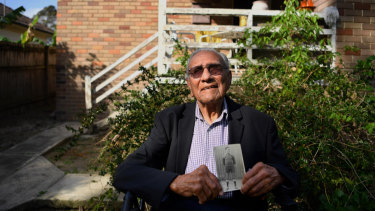 Isaac Bates is the oldest living Redfern All Black. He is holding a photo of himself age 17 when he joined the club.