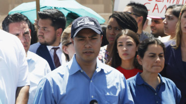 US Representative Joaquin Castro speaks alongside members of the Hispanic Caucus after touring inside of the Border Patrol station in Clint, Texas.