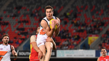 Giant leap: Jeremy Cameron flies against Gold Coast in his Coleman Medal-sealing performance.