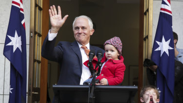 Malcolm Turnbull waves goodbye at the end of his final press conference as prime minister, with granddaughter Alice and grandson Jack.
