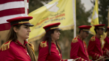 A military band performs ahead of a ceremony at al-Omar Oil Field marking the US-backed Syrian Democratic Forces (SDF) capture of Baghouz, Syria, after months of fighting to oust Islamic State militants on Saturday.
