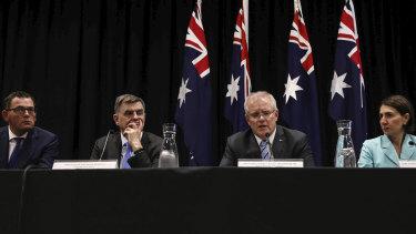 Victorian Premier Daniel Andrews, national Chief Medical Officer Brendan Murphy, Prime Minister Scott Morrison and NSW Premier Gladys Berejiklian on March 13.