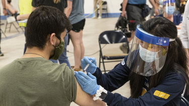 Kent State University student Jarrett Wooes gets his Johnson & Johnson shot prior to its suspension in the US.