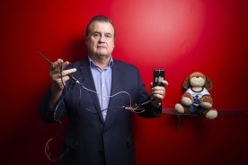 Former policeman Stephen Wilson, who helps family violence survivors debug their online accounts, cars and homes, shows examples of devices Protective Group has found (including a toy in which a device was hidden).