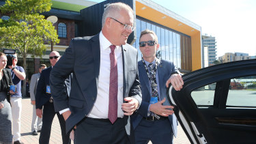 Mr Morrison leaves a press conference during the LNP annual convention in Brisbane on Saturday.