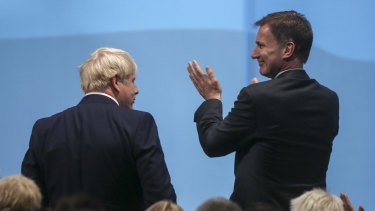 Jeremy Hunt, right, who after losing the leadership battle wanted to remain foreign secretary, turned down defence and is out of cabinet.