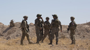 Turkish forces during a joint ground patrol with US forces on the Syrian side of the border with Turkey, near Tal Abyad, Syria in September.