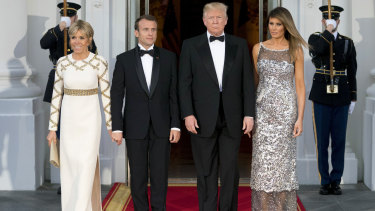US first lady Melania Trump and French first lady Brigitte Macron attend a state dinner.