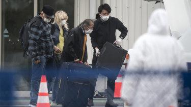 Passengers disembark the quarantined Diamond Princess.