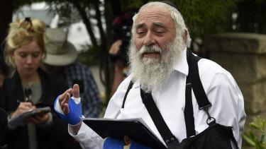 Rabbi Yisroel Goldstein outside Poway synagogue.