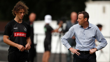 Collingwood CEO Mark Anderson (right) with Chris Mayne during a pre-season training session at Olympic Park Oval.