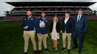 Paul Doorn, far right, with Waratahs staff and players, and a Newcastle councillor, at McDonald Jones Stadium in Newcastle last year.