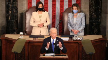 Joe Biden, flanked by Vice-President Kamala Harris and House Speaker Nancy Pelosi, delivers his first major speech to Congress as US President.
