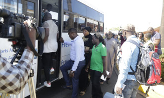 Relatives of the victims board a bus at Jomo Kenyatta International Airport, Nairobi.