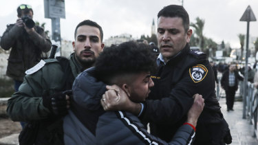 Israeli border police arrests a Palestinian ahead of a protest against Middle East peace plan announced Tuesday by US President Donald Trump.