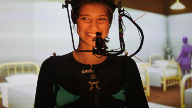 Actress Lily Sullivan wears a motion capture suit while filming her role as a nurse in the film.