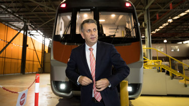 Transport Minister Andrew Constance in front of a mock of one of the new intercity trains.