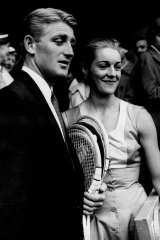 Reigning champion, Lew Hoad, arrives at Wimbledon with his wife, June 24, 1957.
