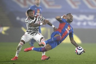 Manchester United's Fred (left) challenges Crystal Palace's Jordan Ayew.