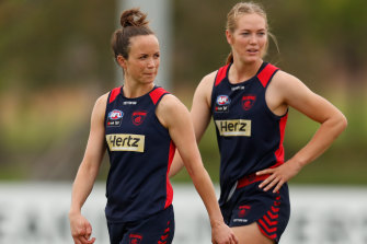 Melbourne skipper Daisy Pearce, left, watches on as the Dees take part in a pre-season practice match.