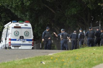 Police on Simmat Avenue near the intersection with Curtin Place in Condell Park where the shooting took place.