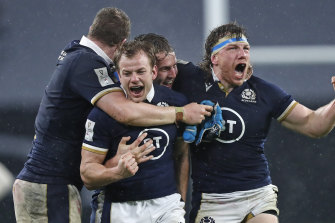 Scotland's Hamish Watson, right, and teammates celebrate at the end of the Six Nations rugby union international between England and Scotland at Twickenham stadium in London, Saturday, Feb. 6, 2021.