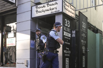 Police leave the Bondi Beach Backpackers after breaking up a public indoor gathering on Friday night.