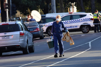 Police at the scene of the fatal shooting outside the Melbourne Pavilion in Kensington in March last year.
