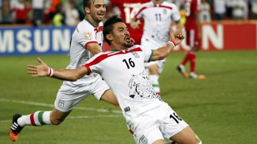 Gucci man: Reza Ghoochannejhad celebrates after scoring for Iran at the 2015 Asian Cup in Australia. He could be back in the country soon if his proposed deal with Sydney FC is completed.