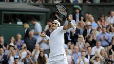 Roger Federer celebrates defeating Rafael Nadal during their semi-final.