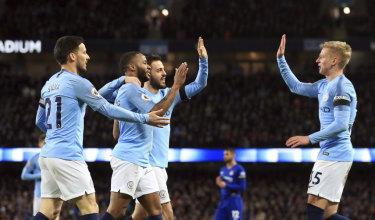 Manchester City players celebrate a Raheem Sterling goal against Chelsea.