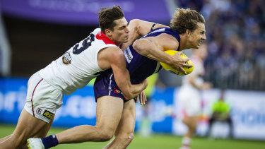 Jack Steele tackles Fremantle's Nat Fyfe in last Sunday's match.