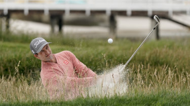 Australia's Adam Scott digs his way out of trouble at this year's US Open.